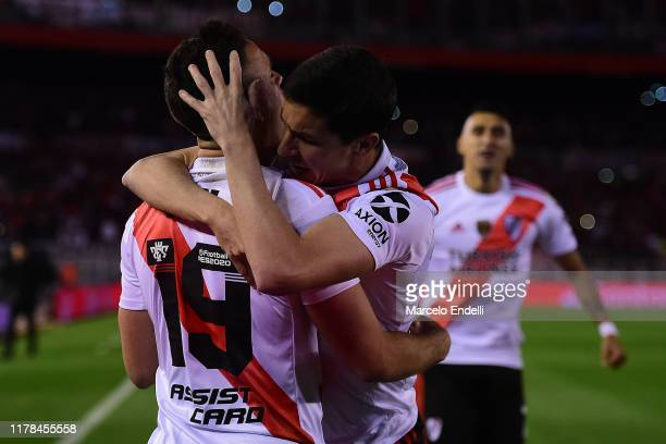 Rafael Santos Borre of River Plate celebrates with teammate Ignacio Fernandez after scoring the opening goal via penalty after a VAR review during...