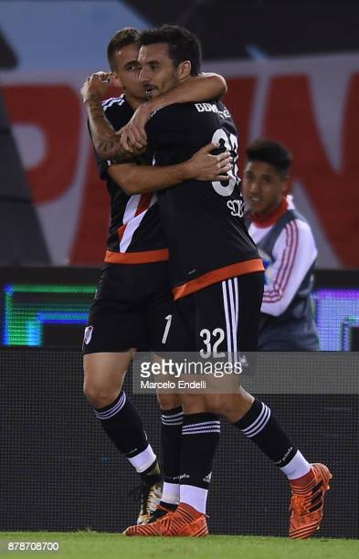 Rafael Santos Borre of River Plate celebrates with teammate Ignacio Scocco after scoring the first goal of his team during a match between River and...