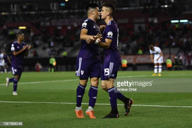 Rafael Santos Borre of River Plate celebrates with teammates after scoring the second goal of his team during a match between River Plate and...