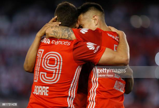 Rafael Santos Borre of River Plate celebrates with teammates Carlos Auzqui and Nicolas De La Cruz after scoring the second goal of his team during a...