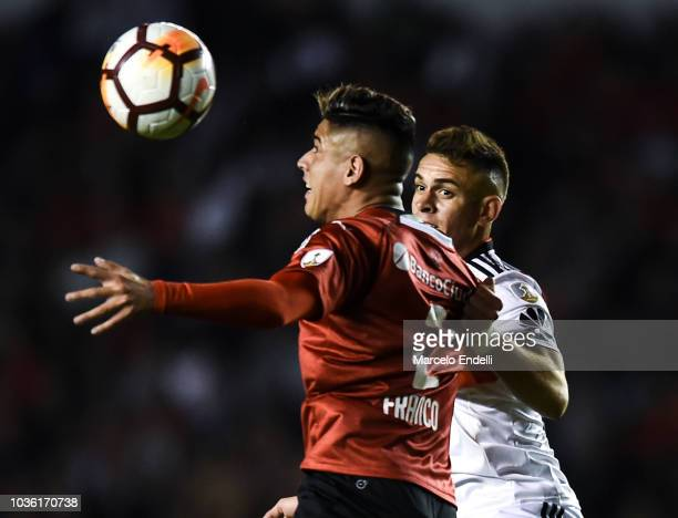 Rafael Santos Borre of River Plate fights for the ball with Alan Franco of Independiente during a quarter final first leg match between Independiente...