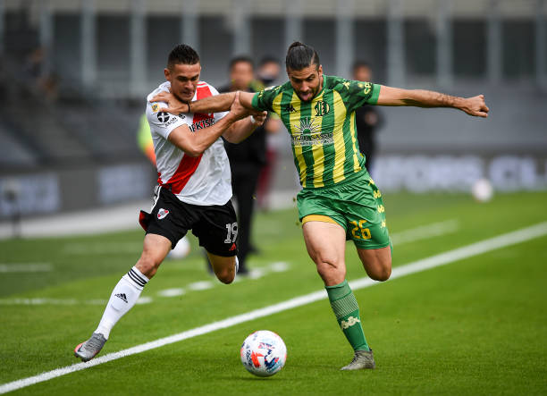 Rafael Santos Borre of River Plate fights for the ball with Emiliano Insua of Aldosivi during a match between River Plate and Aldosivi as part of...
