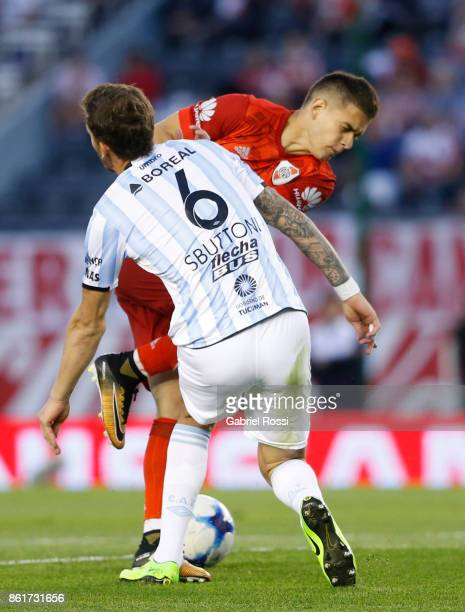 Rafael Santos Borre of River Plate fights for the ball with Franco Sbuttoni of Atletico de Tucuman during a match between River Plate and Atletico de...