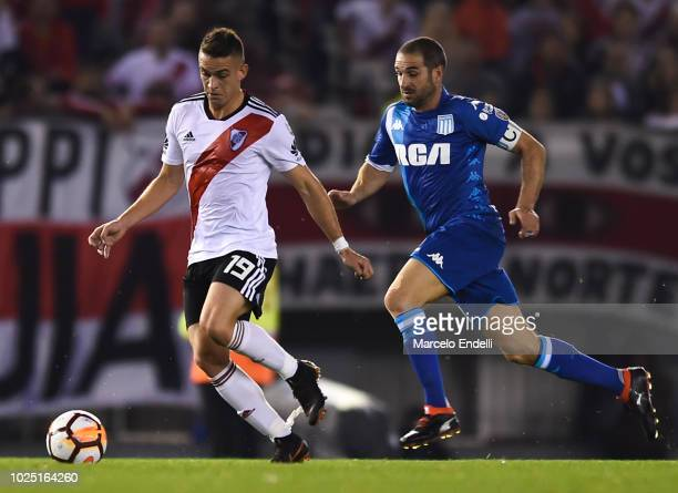 Rafael Santos Borre of River Plate fights for the ball with Lisandro Lopez of Racing Club during a round of sixteen second leg match between River...