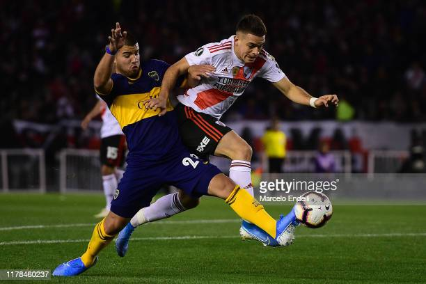 Rafael Santos Borre of River Plate fights for the ball with Marcelo Weigandt of Boca Juniors during the semi final first leg match between River...