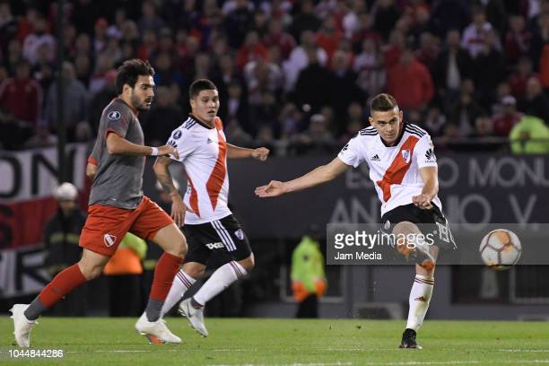 Rafael Santos Borre of River Plate kicks the ball to score the third goal of his team during a quarter final second leg match of Copa CONMEBOL...