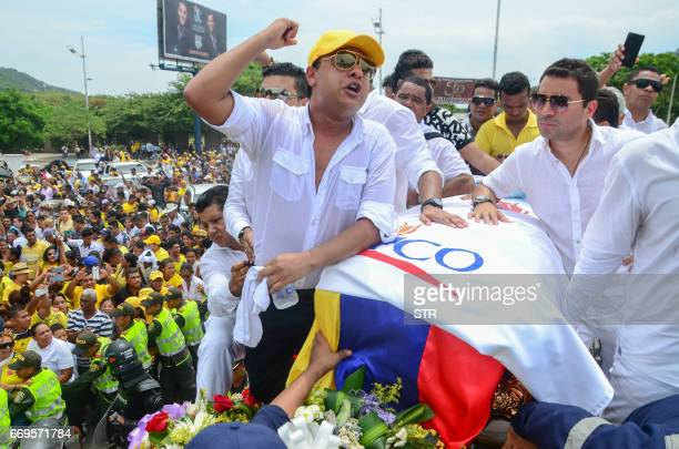 Rafael Santos Diaz brother of Colombian singer Martin Elias cries over the coffin during his funeral in Valledupar northern Colombia on April 17 2017...
