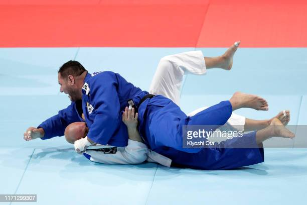 Rafael Silva of Brazil throws Henk Grol of the Netherlands in the Men's +100kg Repechage on day seven of the World Judo Championships at the Nippon...