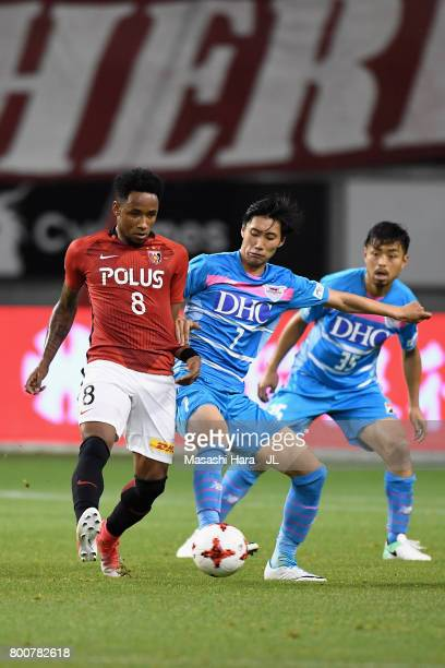 Rafael Silva of Urawa Red Diamonds and Daichi Kamada of Sagan Tosu compete for the ball during the JLeague J1 match between Sagan Tosu and Urawa Red...