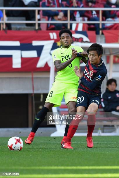 Rafael Silva of Urawa Red Diamonds and Kento Misao of Kashima Antlers compete for the ball during the JLeague J1 match between Kashima Antlers and...