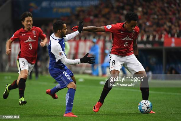 Rafael Silva of Urawa Red Diamonds and Mohammed AlBurayk of AlHilal compete for the ball during the AFC Champions League Final second leg match...