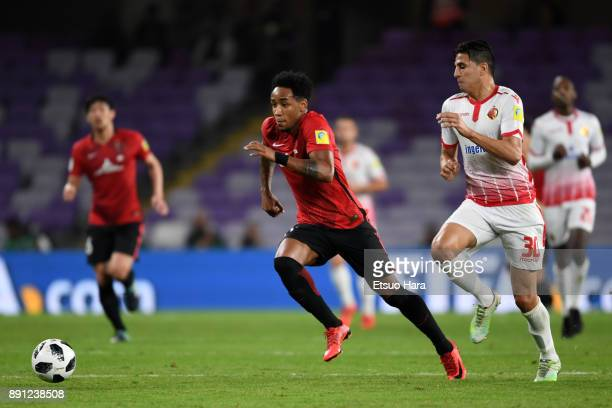 Rafael Silva of Urawa Red Diamonds and Mohammed Nahiri of Wydad Casablanca compete for the ball during the FIFA Club World Cup UAE 2017 Match for 5th...