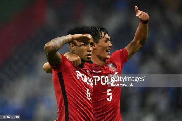 Rafael Silva of Urawa Red Diamonds celebrates scoring his side's second goal with his team mate Tomoaki Makino during the JLeague J1 match between...