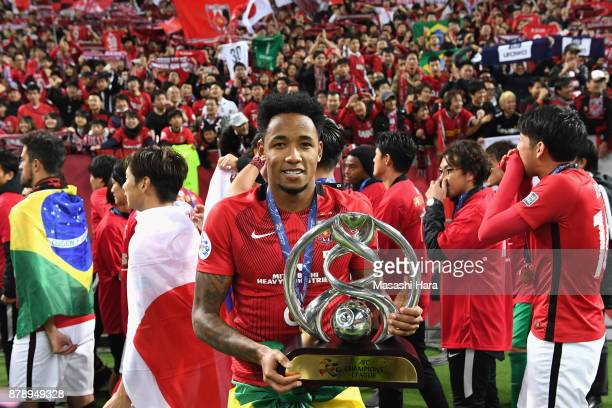 Rafael Silva of Urawa Red Diamonds celebrates with the trophy after the AFC Champions League Final second leg match between Urawa Red Diamonds and...