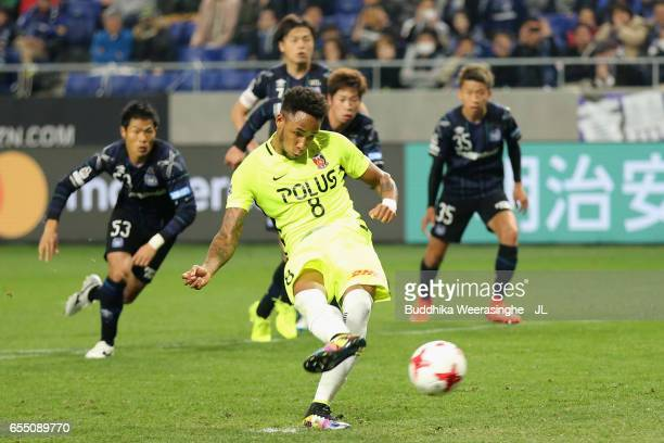 Rafael Silva of Urawa Red Diamonds converts the penalty to score his side's first goal during the JLeague J1 match between Gamba Osaka and Urawa Red...