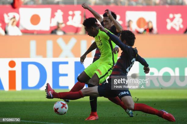 Rafael Silva of Urawa Red Diamonds shoots at goal while Kento Misao and Naomichi Ueda of Kashima Antlers try to block during the J.League J1 match...