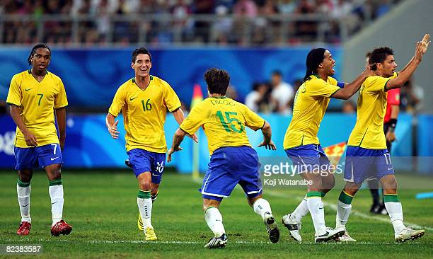 Rafael Sobis of Brazil celebrates the first goal with teammates during the Men's Quarter Final match between Brazil and Cameroon at Shenyang Olympic...