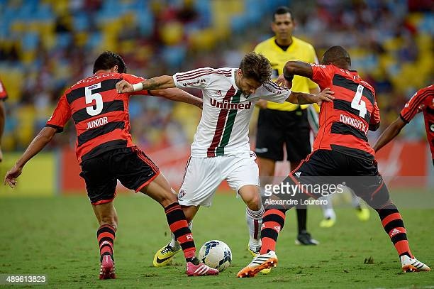 Rafael Sobis of Fluminense battles for the ball with Caceres and Samir of Flamengo during the match between Fluminense and Flamengo as part of...