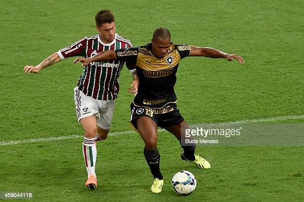 Rafael Sobis of Fluminense struggles for the ball with Andre Bahia of Botafogo during a match between Fluminense and Botofogo as part of Brasileirao...