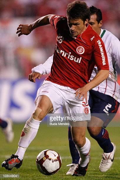 Rafael Sobis of Internacional struggles for the ball with De Luna of Chivas during a match as part of the 2010 Copa Santander Libertadores at Beira...