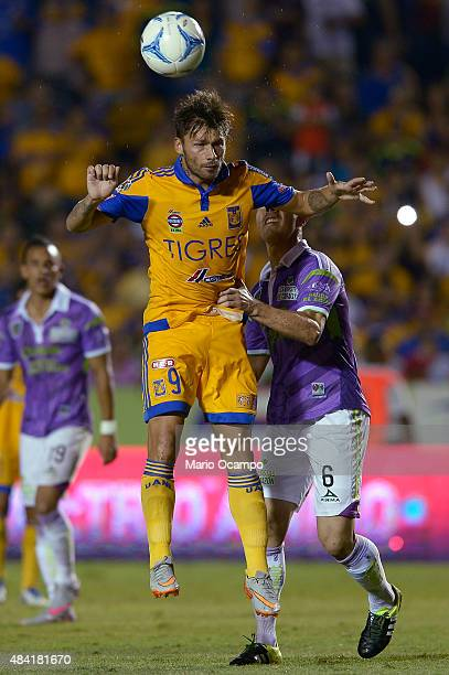 Rafael Sobis of Tigres heads the ball over the mark of Francisco Silva of Chiapas during a 5th round match between Tigres UANL and Chiapas as part of...