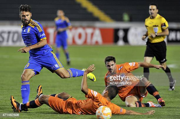Rafael Sobis of Tigres of Mexico vies for the ball with Leonardo Castro and Jorge Cuellar of Bolivia's Universitario de Sucre during their...
