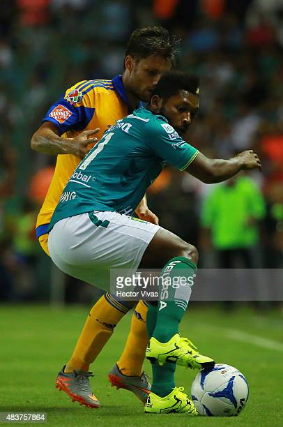 Rafael Sobis of Tigres struggles for the ball with Jonathan Gonzales of Leon during a 4th round match between Leon and Tigres UANL as part of the...
