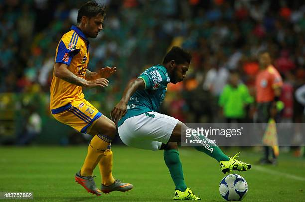 Rafael Sobis of Tigres struggles for the ball with Jonathan Gonzalez of Leon during a 4th round match between Leon and Tigres UANL as part of the...