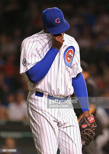 Rafael Soriano of the Chicago Cubs leaves the field after giving up a goahead home run to Carlos Gonzalez of the Colorado Rockies in the top of the...