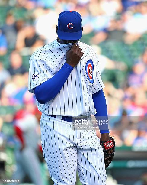 Rafael Soriano of the Chicago Cubs walks off of the field after giving up a tworun home run in the 10th inning to Jeff Francoeur of the Philadelphia...