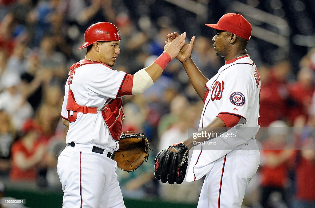 Rafael Soriano #29 of the Washington Nationals celebrates with Wilson Ramos #40 after a 7-4 victory against the Chicago White Sox at Nationals Park on April 11, 2013 in Washington, DC.