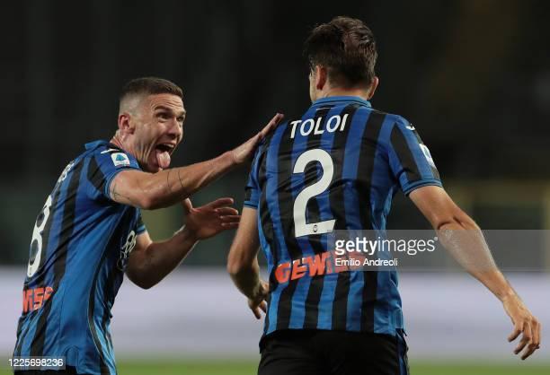 Rafael Toloi of Atalanta BC celebrates with his team-mate Robin Gosens after scoring the opening goal during the Serie A match between Atalanta BC...