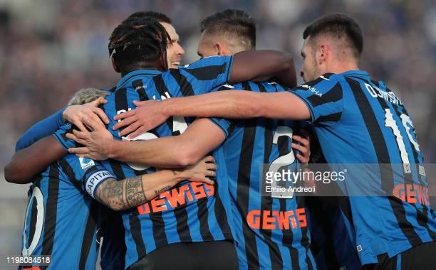 Rafael Toloi of Atalanta BC celebrates with his team-mates after scoring the opening goal during the Serie A match between Atalanta BC and Genoa CFC...
