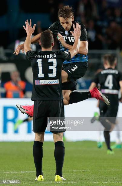 Rafael Toloi of Atalanta BC celebrates with Mattia Caldara after his teammate Andrea Conti scored during the Serie A match between Atalanta BC and AC...