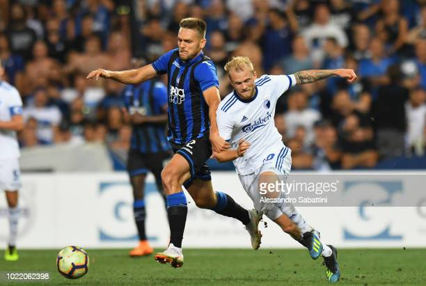 Rafael Toloi of Atalanta BC competes for the ball with Nicolai Boilesen of FC Copenhagen during the UEFA Europa League PlayOff between Atalanta BC...