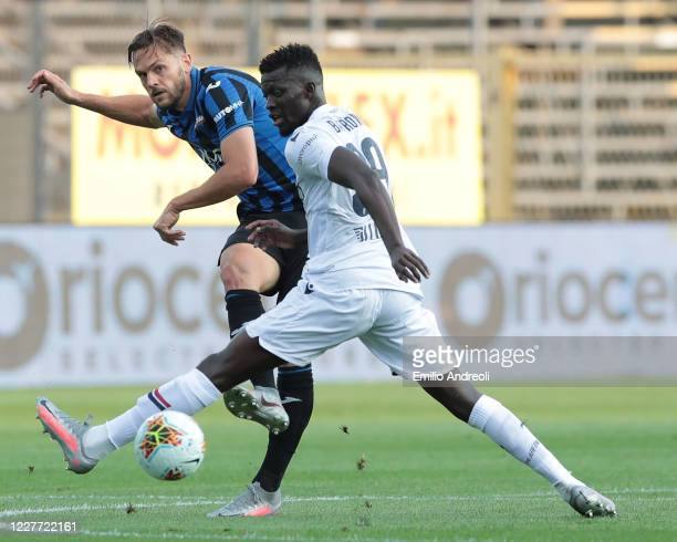 Rafael Toloi of Atalanta BC is challenged by Musa Barrow of Bologna FC during the Serie A match between Atalanta BC and Bologna FC at Gewiss Stadium...