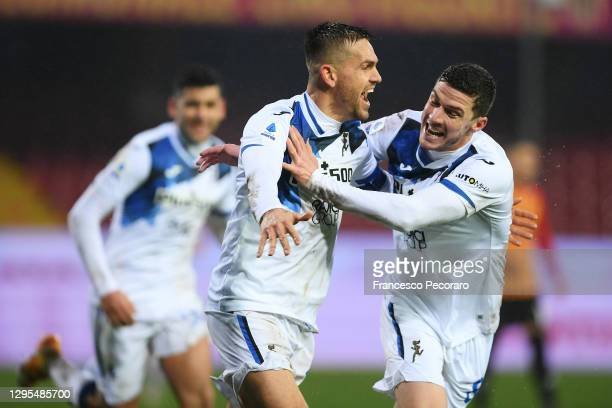 Rafael Toloi of Atalanta celebrates with teammate Robin Gosens after scoring their sides second goal during the Serie A match between Benevento...