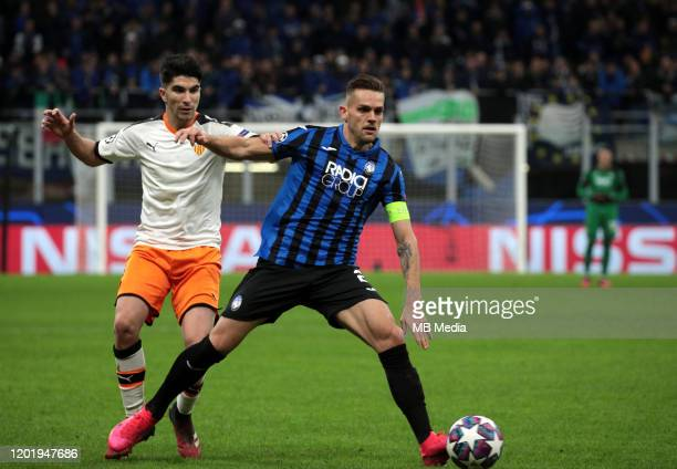 Rafael Toloi of Atalanta competes for the ball with Carlos Soler of Valencia CF during the UEFA Champions League round of 16 first leg match between...