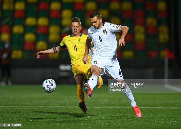 Rafael Toloi of Italy competes for the ball with Arvydas Novikovas of Lithuania during the FIFA World Cup 2022 Qatar qualifying match between...
