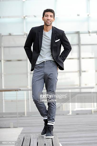 Rafael Valentino actor and chess player is seen wearing Grungy Gentleman pants with cuffed hems and a gray longsleeve tshirt with his own Armani...