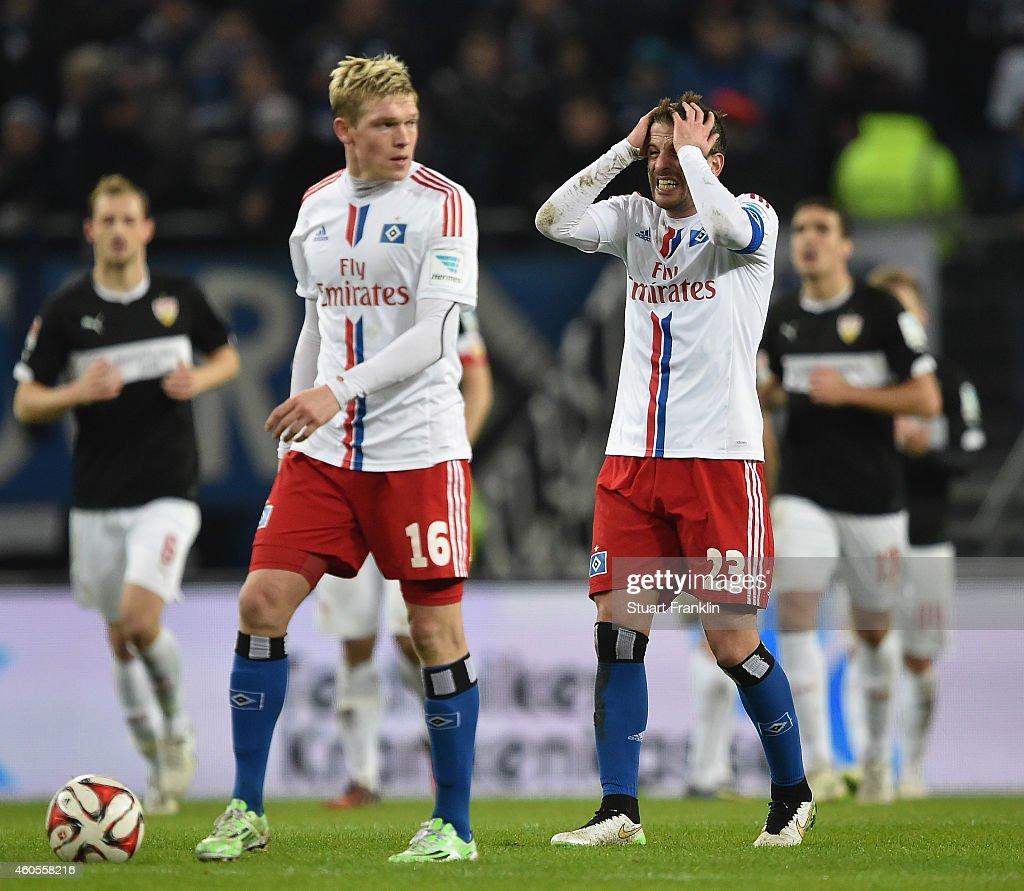 Rafael Van der Vaart and Artjom Rudnevs of Hamburg look dejected during the Bundesliga match between Hamburger SV and VfB Stuttgart at Imtech Arena on December 16, 2014 in Hamburg, Germany.