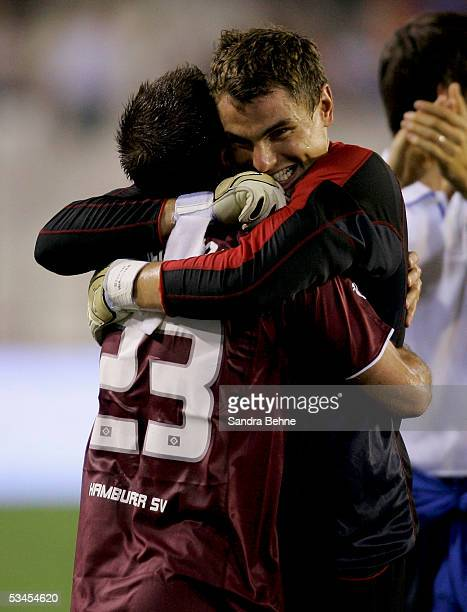 Rafael van der Vaart and goalkeeper Stefan Waechter of Hamburger SV celebrate their victory after the Intertoto Cup Final between FC Valencia and...