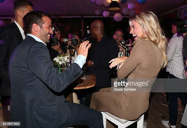 Rafael van der Vaart and his girlfriend Estavana Polman jokes during the Raffaello Summer Day 2016 to celebrate the 26th anniversary of Raffaello on...