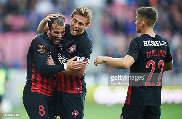Rafael van der Vaart and Jakob Poulsen of FC Midtjylland celebrate after scoring their second goal during the Danish Alka Superliga match between FC...