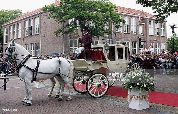 Rafael van der Vaart and Sylvie Meiss arrive in a horse drawn coach during their wedding ceremony on June 10, 2005 in Heemskerk, Netherlands.