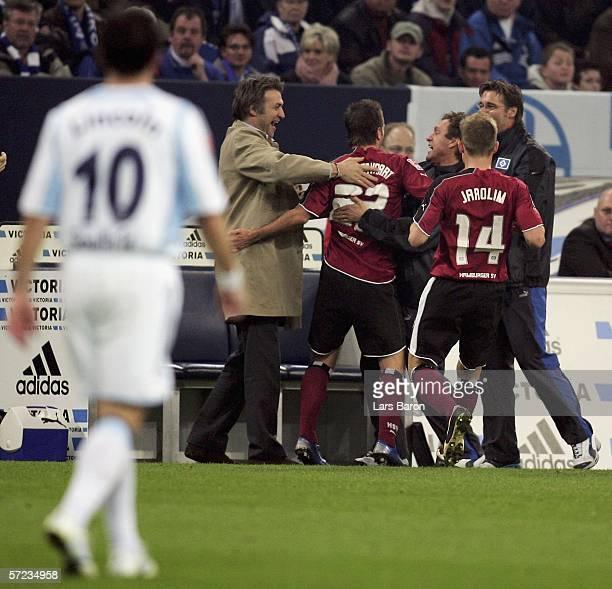 Rafael van der Vaart celebrates scoring the first goal with Detmar Beiersdorfer and coach Thomas Doll during the Bundesliga match FC Schalke 04 and...