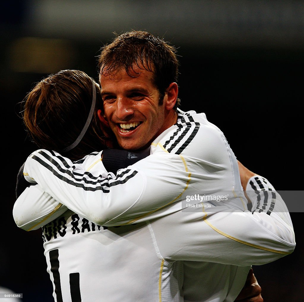 Rafael Van der Vaart (R) celebrates with Sergio Ramos (L) after scoring during the La Liga match between Real Madrid and Real Zaragoza at Estadio Santiago Bernabeu on December 19, 2009 in Madrid, Spain.