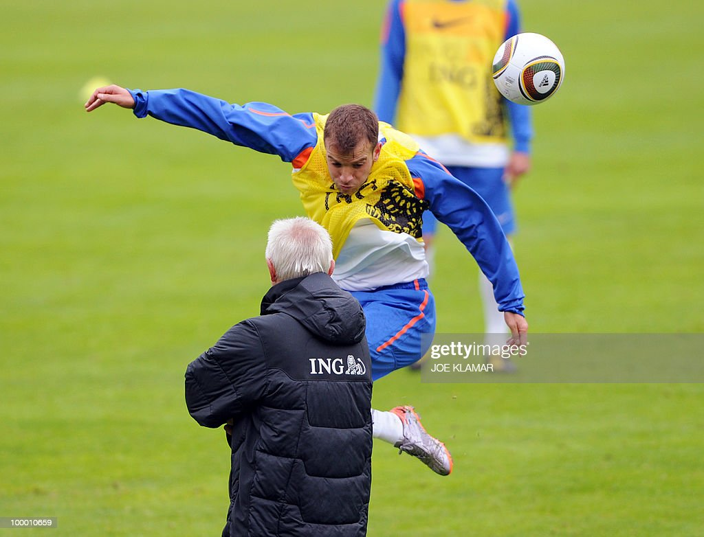 Rafael Van Der Vaart flies by head coach Bert Van Marwijk as he heads a ball during the first Netherland's team's practice on the opening of their training camp in the Tyrolian village of Seefeld in Austria on 20 May 2010 in preparation for the 2010 FIFA World cup hosted by South Africa from June 11 to July 11.