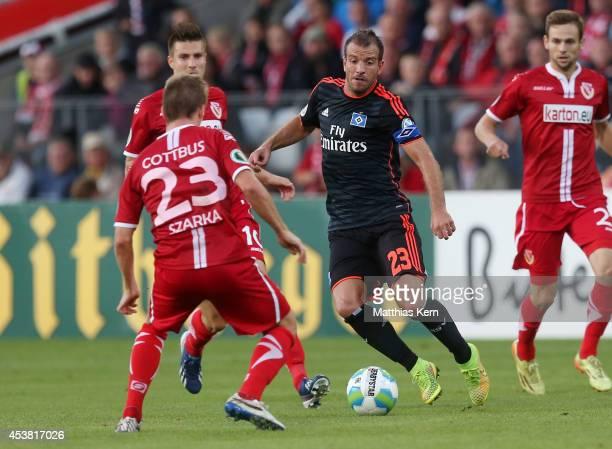 Rafael van der Vaart of Hamburg battles for the ball with Robin Szarka of Cottbus during the DFB Cup match between FC Energie Cottbus and Hamburger...