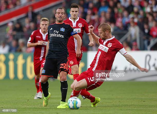 Rafael van der Vaart of Hamburg battles for the ball with Uwe Moehrle of Cottbus during the DFB Cup match between FC Energie Cottbus and Hamburger SV...